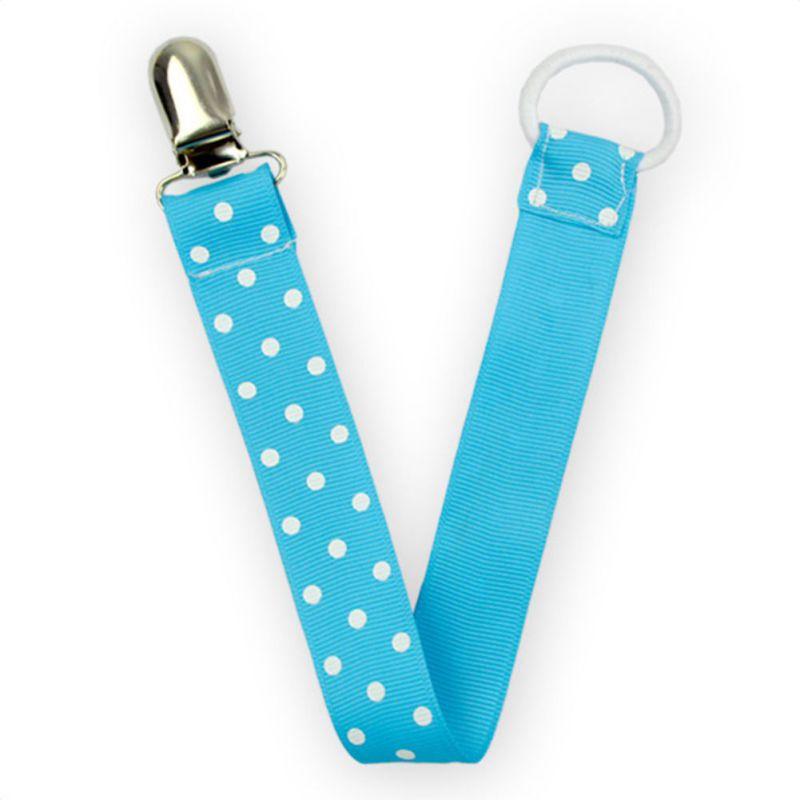 Blå napphållare med vita prickar i polka dot mönster, present baby shower eller dop